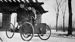 Mr. and Mrs. Henry Ford in his first car, the Ford Quadricycle