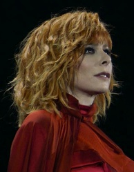 The pop-singer Mylène Farmer holds the record for the most number one hit singles in the French charts.
