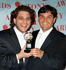Jeff Marx (left) and Robert Lopez (right) receiving their Tony Award in 2004