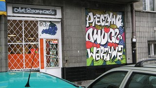 Graffiti as legal advertising on a grocer's shop window in Warsaw, Poland