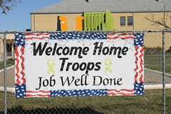 Home-made sign (2015) in Devine, Texas, south of San Antonio, welcomes returning troops from the war in Afghanistan.