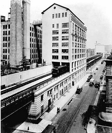 A New York Central train running on the High Line through the Bell Laboratories Building, 1936