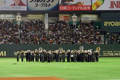 The U.S. 7th Fleet Band and U.S. Army Japan Band perform during the MLB Japan Opening Series 2008.