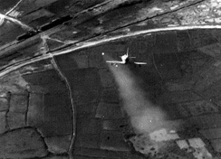 A U.S. Navy Douglas A-4 Skyhawk attacking a train in North Vietnam with a Zuni rocket