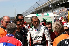 Members of Andretti Green Racing have a meeting on pit road at the Indianapolis Motor Speedway in May 2007.