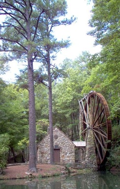 An overshot waterwheel standing 42 ft (13 m) high powers the Old Mill at Berry College in Rome, Georgia, United States