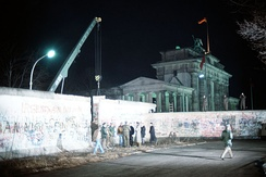 A crane removes a section of the Berlin Wall near Brandenburg Gate on 21 December 1989.