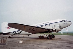 A Douglas DC-3 painted in Ruskin Air Services fictional markings during filming at Duxford Airfield in 1982 for the British television series Airline.