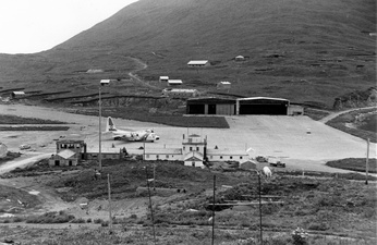 View of Dutch Harbor ramp area with a USCG C-130 Hercules in stand by for an emergency flight.