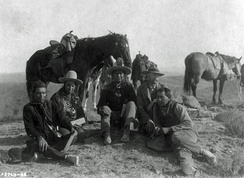 Three of Custer's scouts accompanying Edward Curtis on his investigative tour of the battlefield, circa 1907. Left to right: Goes Ahead, Hairy Moccasin, White Man Runs Him, Curtis and Alexander B. Upshaw (Curtis's assistant and Crow interpreter).