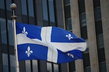 The Fleurdelisé flying at Place d'Armes in Montreal.