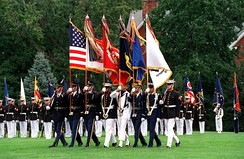 The U.S. Joint Service Color Guard on parade at Fort Myer, Virginia in October 2001. This joint color guard shows the organizational colors of each branch (left to right):National, U.S. Army, U.S. Marine Corps, U.S. Navy, U.S. Air Force, and the U.S. Coast Guard.