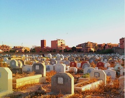 A Muslim cemetery at sunset in Marrakech, Morocco