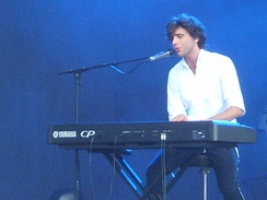 Mika playing keyboard at V Festival 2007 in Weston Park, Staffordshire