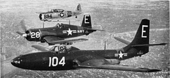 Three aircraft of the Minneapolis U.S. Naval Air Reserve (front to back): an FH-1 Phantom, an F4U-1 Corsair, and an SNJ Texan in 1951.