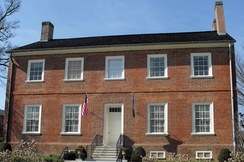 The governor's mansion was damaged by a fire during Bradley's term