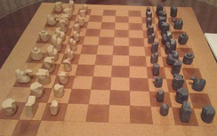 Tamerlane chess, invented by Emperor Shujauddin Timur. The pieces approximate the appearance of the chess pieces in 14th century.