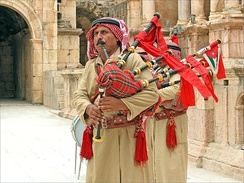 Jordanian military marching band playing bagpipes in Jerash.