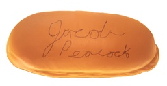 A souvenir hotdog bun from Tony Packo's Cafe signed by the photographer.