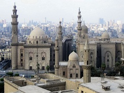 Mosque-Madrassa of Sultan Hassan (left) along with the later Al-Rifa'i Mosque (right) and two Ottoman mosques (foreground) – Cairo