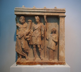 Votive relief of Dionysus and Pluto with adorant. 4th century BC. From Karystos, Archaeological museum of Chalkida.