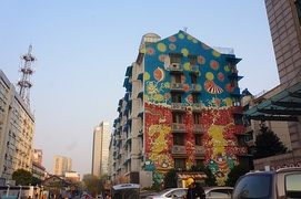 "The Graffiti Piece ""Tante"" (by Chen Dongfan) on the surface wall of an old residential building in Hangzhou, Zhejiang"
