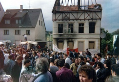 A demonstration condemning the neo-Nazi attacks outside the house of the Turkish victims of the Solingen arson attack of 1993.