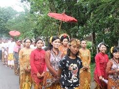 A bridal procession accompanied by live music in Lombok, Indonesia. According to the National Statistical Bureau of Indonesia, the mean age of marriage for women was 22.3 years in 2010, an increase on the 1970 average of 19 years; the corresponding figures for men were 25.7 years and 23 years respectively.[215]