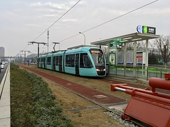 A tram in Chengdu, whose line forms a part of the Chengdu Metro. The city is one of several in China to invest in tram systems in the early 21st century