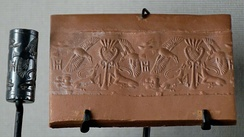 Antelopes attacked by birds: cylinder seal in hematite and its impression. Late Bronze Age II (maybe 14th century BC), from Cyprus in the Minoan period, following Near Eastern precedents.