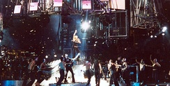 "Madonna during the final performance of the show, ""Music"", flanked by all her dancers."