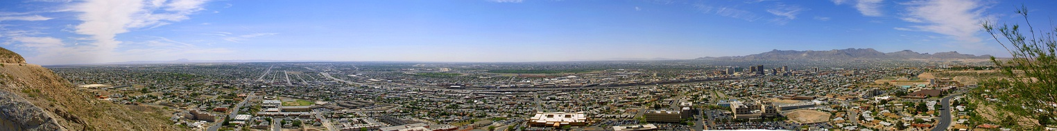 A panoramic view of El Paso, looking northeast through south, near Scenic Drive. The Hueco Mountains can be seen toward the east, and Downtown El Paso can be seen to the south (far right of the image).