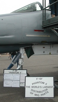 "An F-4F on display described as the ""World's largest distributor of MiG parts"", because of the high number of this type of enemy aircraft shot down"
