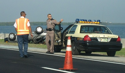 A state trooper supervising the cleanup of a traffic accident in Troop C.