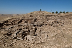 Some henges at Göbekli Tepe were erected as far back as 9600 BC, predating those of Stonehenge, England, by over seven millennia.[42]