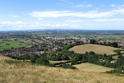 The town of Glastonbury looking west from the top of Glastonbury Tor. The fields in the distance are the Somerset Levels.