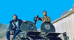 KGB special operative Igor Morozov sits on top of the BTR-60 armoured vehicle during his assignment to the Badakhshan province, c. 1982