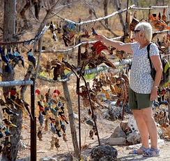 Tourist buying handicrafts in Namibia, an important source of income for some tourist-destinations