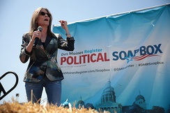 "Marianne Williamson speaking with supporters at the Des Moines Register's ""Political Soapbox"" event"