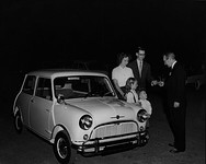 The first Morris Mini-Minor sold in Texas being delivered to a family in Arlington, Texas, in 1959