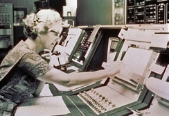 Roman sits at the control console for the Orbiting Astronomical Observtory satellite, launched in 1972 and nicknamed Copernicus. This is a publicity picture; she never actually worked in the Goddard control room.[28]