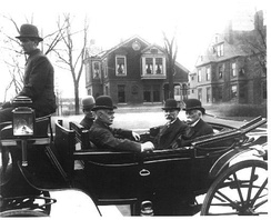 William S. Linton (3rd from left) with dignitaries attend the construction site of Saginaw's City Auditorium on South Washington and Janes in 1908. From left to right: Unknown (driver), Edward Hartwick (editor), William S. Linton, Mayor William B. Baum, Wellington R. Burt (businessman).