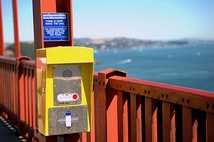 As a suicide prevention initiative, these signs on the Golden Gate Bridge promote a special telephone that connects to a crisis hotline, as well as a 24/7 crisis text line.