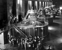 Tourists gather around one of the generators in the Nevada wing of the powerhouse to hear its operation explained, September 1940