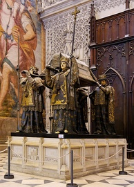 Tomb in Seville Cathedral. The remains are borne by kings of Castile, Leon, Aragon and Navarre.[90]