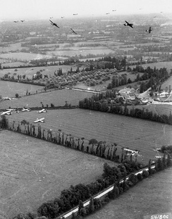 Gliders are delivered to the Cotentin Peninsula by Douglas C-47 Skytrains. 6 June 1944