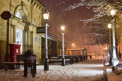 Early winter snowfall on Railway Road in the town centre