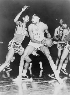Russell defends against Wilt Chamberlain of the Philadelphia 76ers in 1966