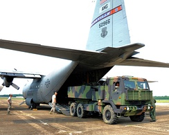 A High Mobility Artillery Rocket System (HIMARS) vehicle is loaded into one of four C-130 aircraft from the 118th Airlift Wing June 4, 2011 as the Tennessee Army National Guard's 1/181st Field Artillery Battalion headed to Fort Chaffee, Ark. for two weeks of annual training.