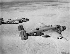 North American B-25D-20 Mitchells of the 12th Bomb Group over North Africa, 1943. Serial 42-87113 in foreground.